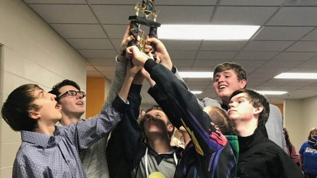 Members of O'Gorman ''Ovation'' hold the Grand Champion trophy from Aberdeen Central up high